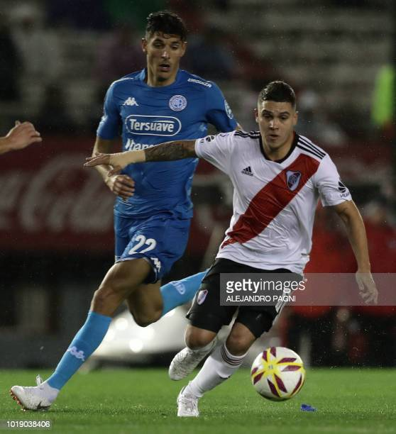 River Plate's Colombian midfielder Juan Quintero controls the ball past Belgrano's midfielder Gabriel Alanis during their Argentina first division...