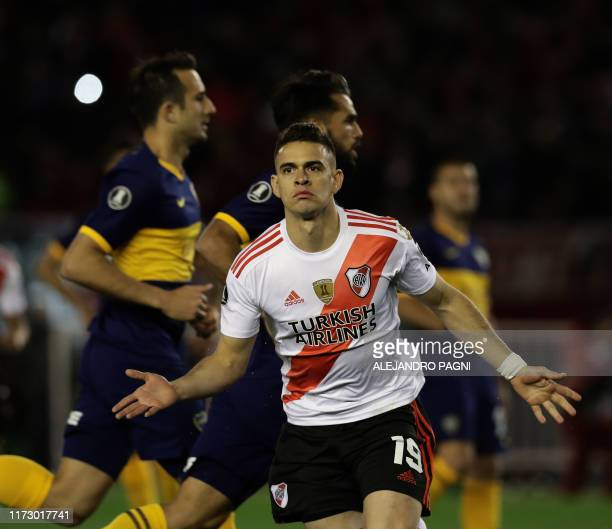 River Plate's Colombian Rafael Santos Borre celebrates after scoring a penalty against Boca Juniors during their allArgentine Copa Libertadores...
