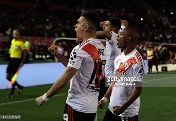 River Plate's Colombian Rafael Santos Borre celebrates next to Uruguayan teammate Nicolas de la Cruz after scoring a penalty against Boca Juniors...