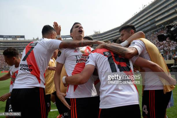 River Plate's Colombian Rafael Santos Borre celebrates with teammates after scoring against Brazil's Flamengo during the Copa Libertadores final...