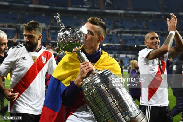 TOPSHOT River Plate's Colombian Rafael Santos Borre celebrates with the trophy after winning the second leg match of the allArgentine Copa...