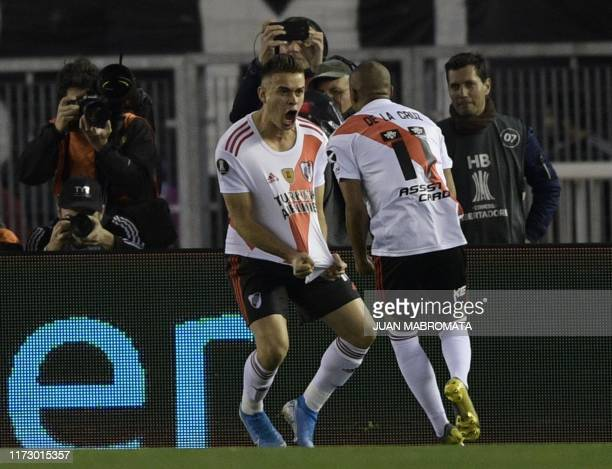 River Plate's Colombian Rafael Santos Borre celebrates with Uruguayan teammate Nicolas de la Cruz after scoring a penalty against Boca Juniors during...