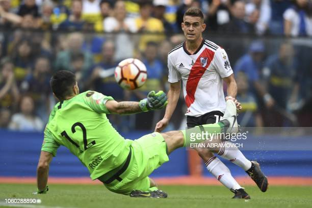 River Plate's Colombian Rafael Santos Borre tries to score past Boca Juniors' goalkeeper Agustin Rossi during the first leg match of their...