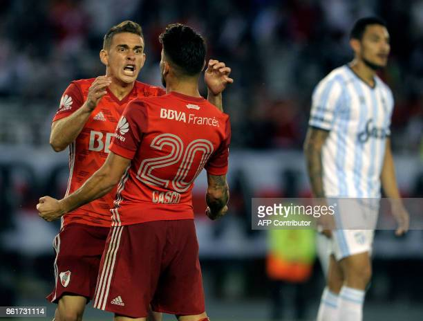 River Plate's defender Milton Casco celebrates with teammate Colombian forward Rafael Borre after scoring a goal against Atletico Tucuman during...