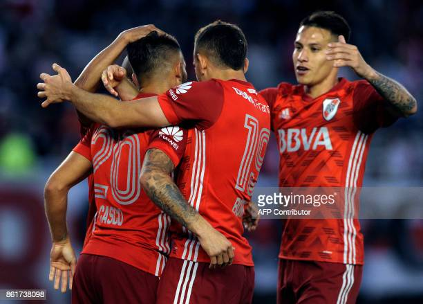 River Plate's defender Milton Casco celebrates with teammates after scoring a goal against Atletico Tucuman during their Argentina First Division...