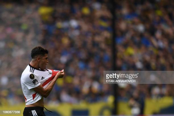 River Plate's Exequiel Palacios celebrates after teammate Lucas Pratto scored their team's first goal against Boca Juniors during their first leg...
