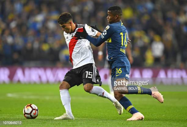 River Plate's Exequiel Palacios is challenged by Boca Juniors' Colombian Wilmar Barrios during the second leg match of their allArgentine Copa...