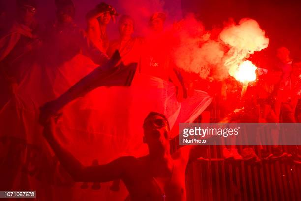 River Plates fan holds a bengal as he celebrates in the obelisk the victory of their football team,Buenos Aires, Argentina, Monday, Dec. 10, 2018....