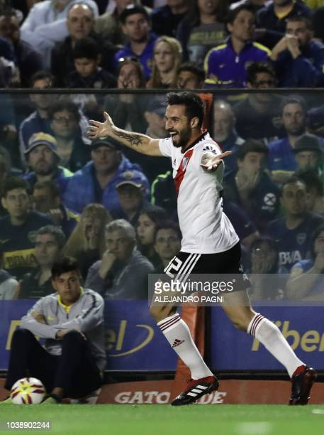 River Plate's forward Ignacio Scocco celebrates after scoring the team's second goal against Boca Juniors during their Argentina First Division...