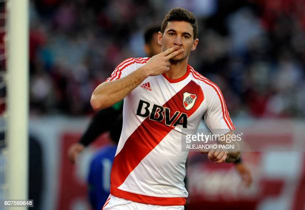 River Plate's forward Lucas Alario celebrates after scoring a goal against San Martin during their Argentina First Division football match at El...