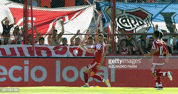 River Plate's forward Lucas Alario celebrates with teammates after scoring on penalty kick against Estudiantes during their Argentina First Division...