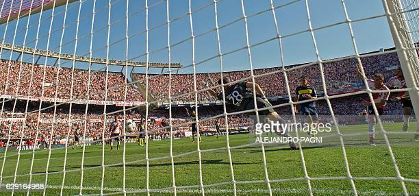 River Plate's forward Lucas Alario scores against Boca Juniors during their Argentina First Division football match at El Monumental stadium in...