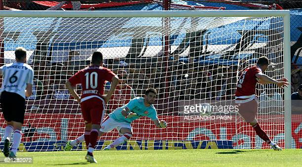 River Plate's forward Lucas Alario shoots a penalty kick and scores against Estudiantes during their Argentina First Division football match at Tomas...