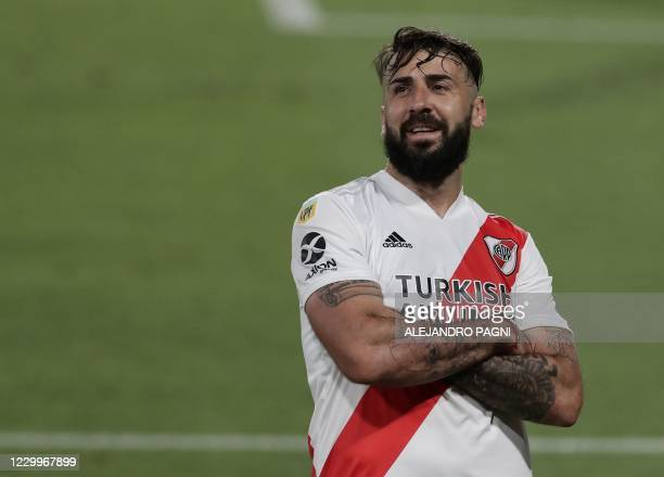 River Plate's forward Lucas Pratto celebrates after scoring the team's third goal against Godoy Cruz during their Argentina First Division 2020 Liga...