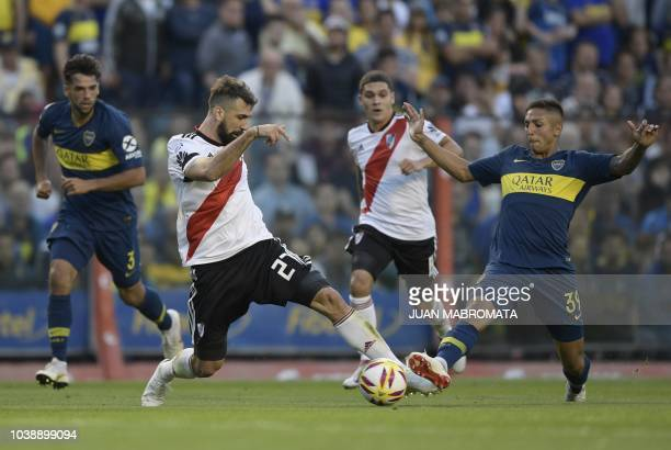 River Plate's forward Lucas Pratto vies for the ball with Boca Juniors' midfielder Agustin Almendra during their Argentine first division Superliga...
