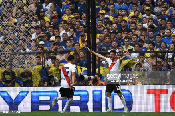 River Plate's Gonzalo Martinez and teammate Exequiel Palacios celebrate an own goal by Boca Juniors' Carlos Izquierdoz during their first leg match...