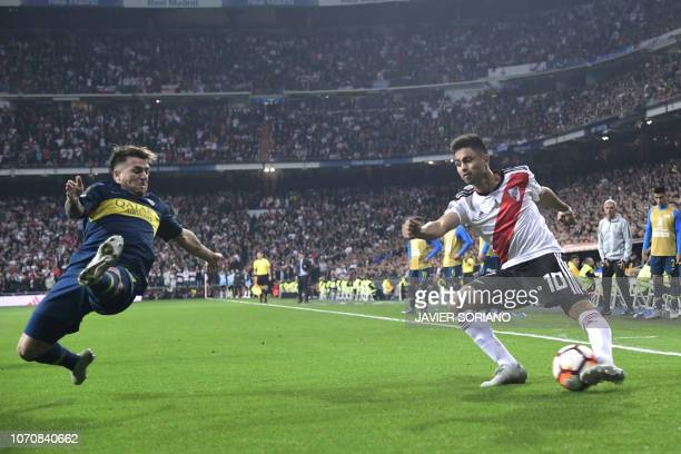 TOPSHOT River Plate's Gonzalo Martinez is challenged by Boca Juniors' Julio Buffarini during the second leg match of their allArgentine Copa...
