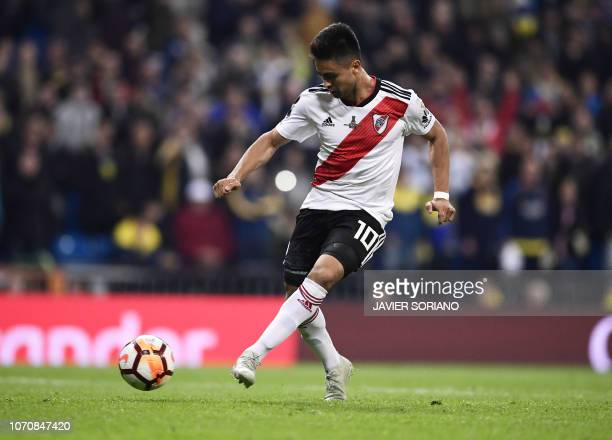 River Plate's Gonzalo Martinez scores against Boca Juniors during the second leg match of the allArgentine Copa Libertadores final at the Santiago...