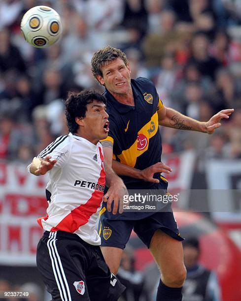 River Plate´s Gustavo Cabra vies for the ball with Boca Junior´s Martin Palermo during the Argentinean Championship Primera A match on October 25...