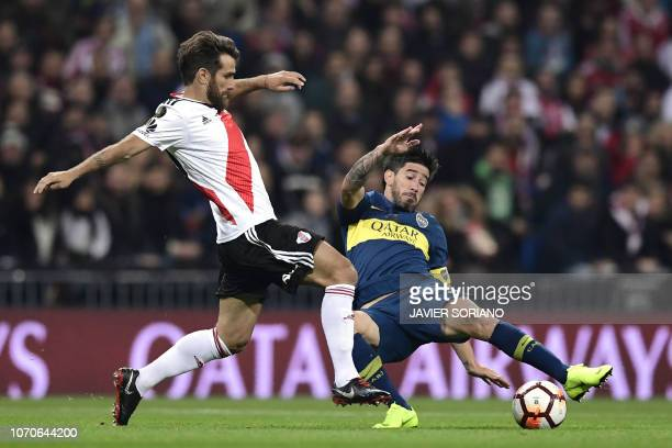River Plate's Leonardo Ponzio and Boca Juniors' Pablo Perez vie for the ball during the second leg match of their allArgentine Copa Libertadores...