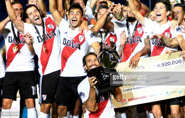 River Plate's Leonardo Ponzio rises the trophy of the Supercopa Argentina 2018 after defeating Boca Juniors in the final football match at Malvinas...