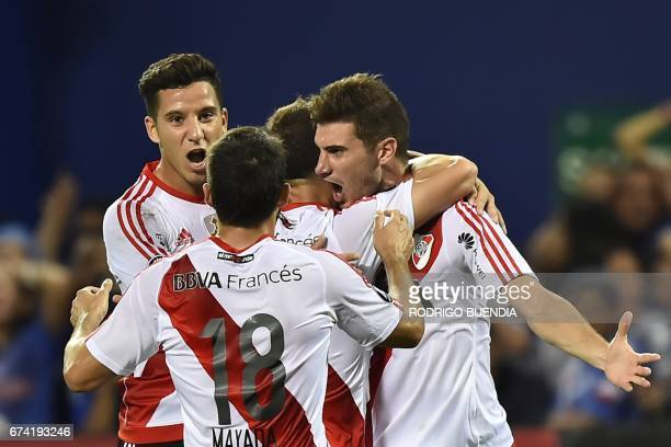 River Plate's Lucas Alario celebrates with teammates a goal against Emelec during their 2017 Copa Libertadores football match at George Capwell...