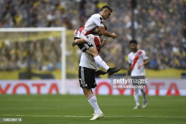 River Plate's Lucas Pratto celebrates with Colombian teammate Rafael Santos Borre after scoring against Boca Juniors during their first leg match of...