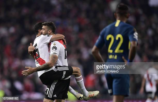 River Plate's Lucas Pratto celebrates with teammate Ignacio Fernandez after scoring against Boca Juniors during the second leg match of the...