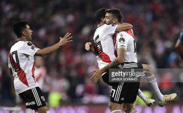 TOPSHOT River Plate's Lucas Pratto celebrates with teammates Ignacio Fernandez and Gonzalo Martinez after scoring against Boca Juniors during the...