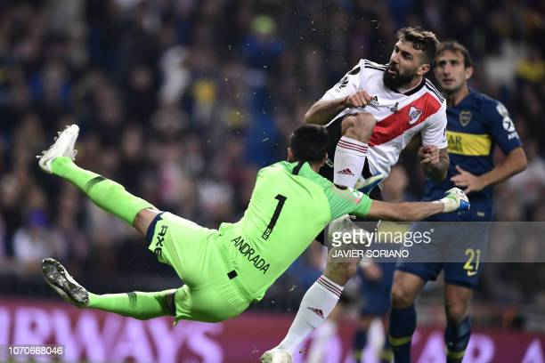 TOPSHOT River Plate's Lucas Pratto collides with Boca Juniors' goalkeeper Esteban Andrada during the second leg match of their allArgentine Copa...