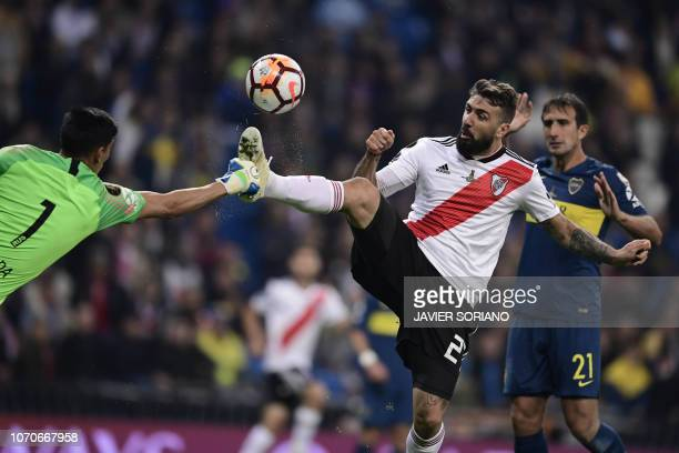 TOPSHOT River Plate's Lucas Pratto vie for the ball with Boca Juniors' goalkeeper Esteban Andrada during the second leg match of their allArgentine...