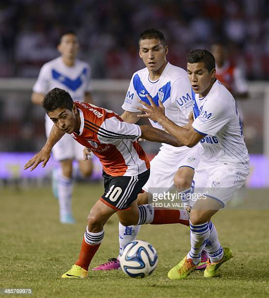River Plate's Manuel Lanzini vies for the ball with Velez Sarsfield's Lucas Romero during their Argentine First Division football match at the...
