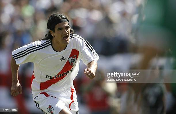 River Plate's midfielder Ariel Ortega celebrates after scoring the team's second goal against Boca Juniors during their Argentine first division...