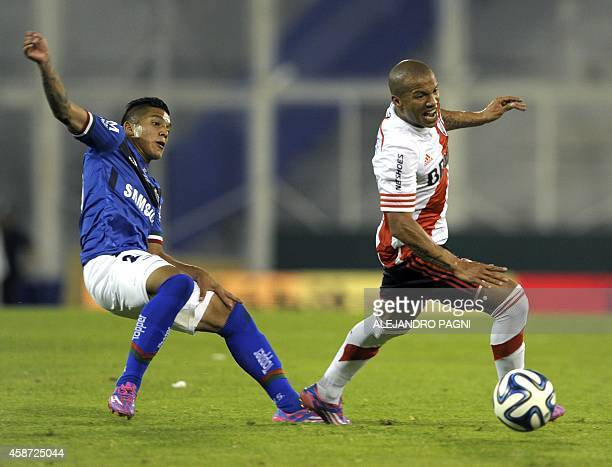 River Plate's midfielder Carlos Sanchez vies for the ball with Velez Sarsfield's midfielder Lucas Romero during their Argentine First Division...