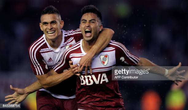 River Plate's midfielder Gonzalo Martinez celebrates with forward teammate Colombian Rafael Borre after scoring the team's second goal against...