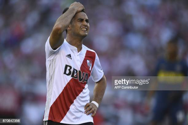 River Plate's midfielder Gonzalo Martinez reacts after missing a goal against Boca Juniors during the Argentine derby match in the Superliga first...