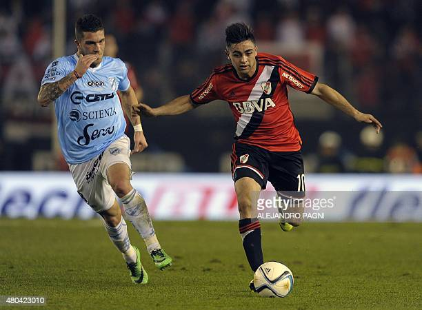 River Plate's midfielder Gonzalo Martinez vies for the ball with Temperley's midfielder Adrian Arregui during their Argentina First Division football...