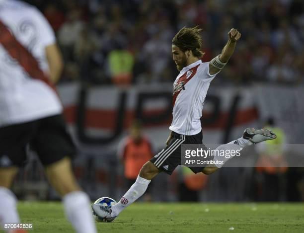 River Plate's midfielder Leonardo Ponzio kicks the ball to score against Boca Juniors during the Argentine derby match in the Superliga first...