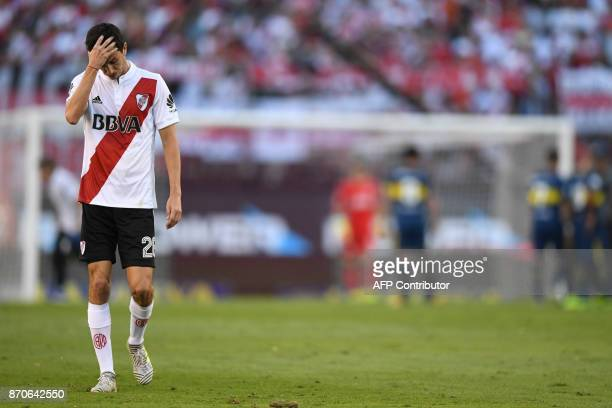 River Plate's midfielder midfielder Ignacio Fernandez leaves the pitch after being expulsed during the Argentine derby match against Boca Juniors in...