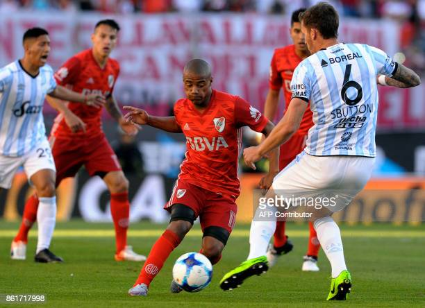 River Plate's midfielder Nicolas De la Cruz vies for the ball with Atletico Tucuman's defender Franco Sbuttoni during their Argentina First Division...