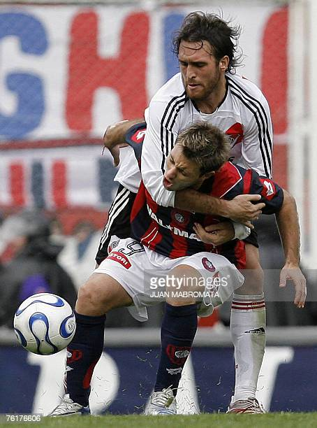 River Plate's Oscar Ahumada vies for the ball with San Lorenzo's Gaston Fernandez during their Argentine First division soccer match at San Lorenzo...