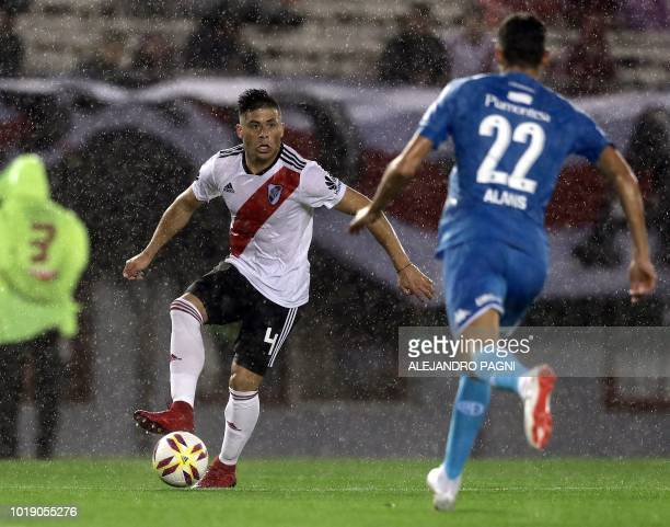 River Plate's Paraguayan defender Jorge Moreira contols the ball in front of Belgrano's midfielder Gabriel Alanis during their Argentina first...
