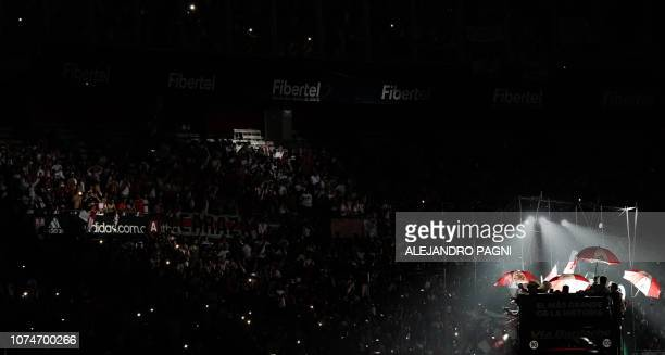 River Plate's players arrive on a bus at the Monumental stadium in Buenos Aires on December 23 to celebrate with fans their 2018 Libertadores Cup...