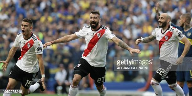 River Plate's Rafael Santos Borre Lucas Pratto and Javier Pinola celebrate after an own goal by Boca Juniors' Carlos Izquierdoz during their first...