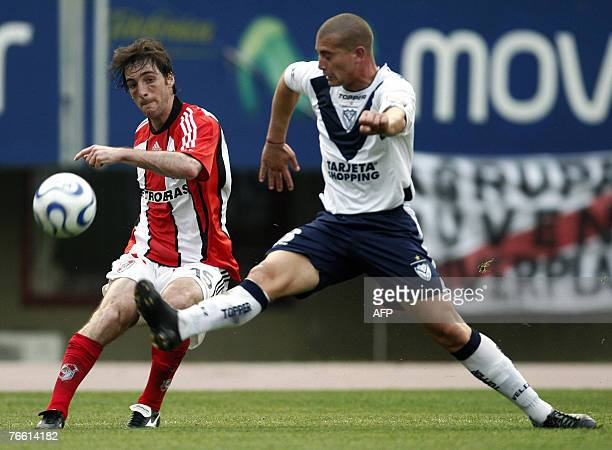 River Plate's Sixto Peralta vies for the ball with Pablo Lima of Velez Sarsfield during their Argentina first division soccer match in Buenos Aires...
