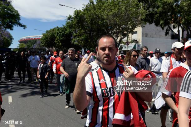 A River Plate's supporter gestures as he leaves the Monumental stadium in Buenos Aires after the allArgentine Copa Libertadores second leg final...