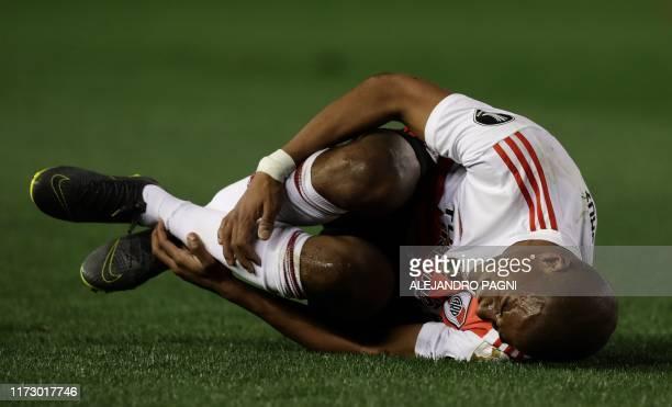 River Plate's Uruguayan Nicolas de la Cruz gestures on the ground during the allArgentine Copa Libertadores semifinal first leg football match...