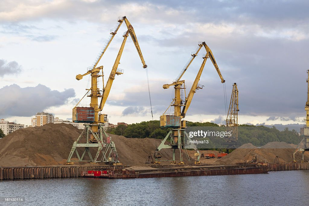 river port and cranes, barge : Stock Photo
