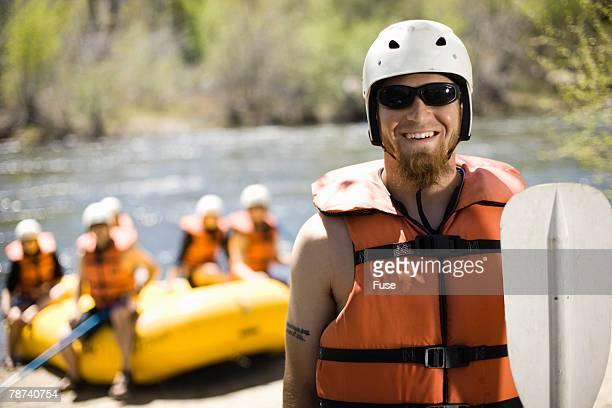 River Rafting Guide Preparing to Take to River
