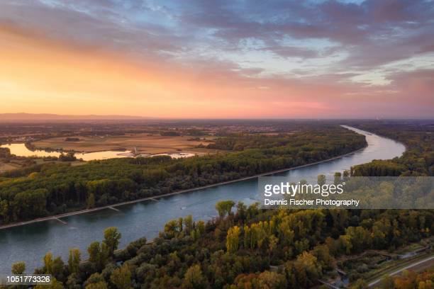 river rhine during sunset - jahreszeit stock-fotos und bilder
